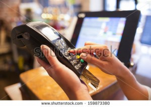 stock-photo-woman-hand-with-credit-card-swipe-through-terminal-for-sale-in-restaurant-159873380